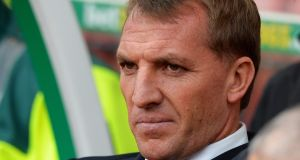 Liverpool manager Brendan Rodgers looks on grimly during the thrashing at Stoke. Photograph:  Tony Marshall/Getty Images