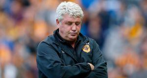 Hull City manager Steve Bruce looks dejected after his side was relegated at the KC Stadium  yesterday. Photograph:  Andrew Yates/Reuters