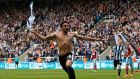 Jonas Gutierrez celebrates after his goal virtually guaranteed Newcastle United's Premier League survival. Photograph: Reuters