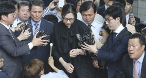 Former Korean Air Lines executive Heather Cho (C) is surround by reporters as she is released at a courthouse in Seoul, South Korea on May 22. Photograph: Reuters/Hwang Kwang-Mo/Yonhap