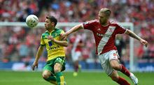 Norwich City's Irish midfielder Wes Hoolahan  is challenged by Middlesbrough's Adam Clayton during the Championship play-off final at Wembley .  Photograph: Getty Images