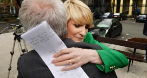 Senator Averil Power gets a hug after announcing her resignation from the Fianna Fáil party  outside Leinster House. Photograph: Cyril Byrne