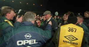 Ireland manager  Jack Charlton on the pitch after English fans had caused the match at Lansdowne Road to be abandoned. Photograph: Inpho/Billy Stickland
