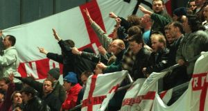 English fans chant in Lansdowne Road during the abandoned international from February 1995. Photograph: Inpho/Lorraine O'Sullivan