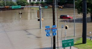 Floodwaters cover an intersection  in Houston, Texas, today.  Photograph: Daniel Kramer/Reuters