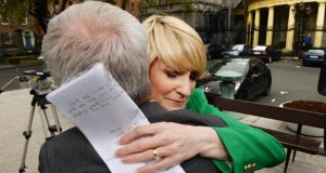 Senator Averil Power gets a hug after her resignation from the Fianna Fail aprty on the plinth outside Leinster House. Photograph: Cyril Byrne / THE IRISH TIMES