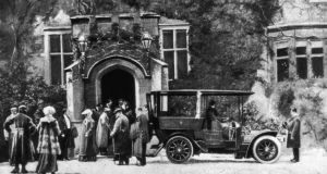 Lismore Castle  has hosted guests such as King Edward VII, above circa 1905, leaving the castle for a spin in a Daimler. Photograph: Hulton/Getty