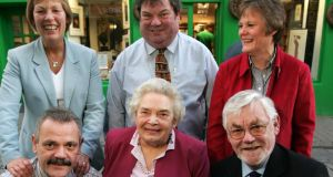 "The Kenny family prior to moving the bookshop from High Street to Liosbán: from left, front, Conor, Maureen, Tom, and back, Jane, Des and Monica. ""Three members of staff are third-generation family, and they, like their grandparents, strive to make Kenny's Bookshop a world of its own, and a key to worlds unknown."" Photograph: Frank Miller"