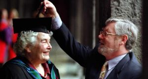 "Tom Kenny and Maureen Kenny, on whom the honorary degree of Master of Arts was conferred at UCG. Part of her citation read: ""She and all she stands for remained a constant when virtually everything around her had disappeared, been redeveloped or surrendered to more perishable, transient tastes. Her metier represents one that is entwined with Galway's history"". Photograph: Joe O'Shaughnessy"