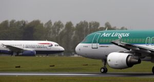 British Airways and Aer Lingus jets pass each other at Dublin airport. Photograph: Niall Carson/PA Wire