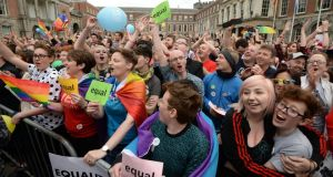 'I was emotionally overwhelmed by the acknowledgment of my small part in their campaign but I was also deeply distressed by the intensity of their gratitude.' Above, crowds celebrate in the court yard at Dublin Castle, the Central Results Centre, at the results of the referendum on marriage equality. Photograph: Dara Mac Dónaill / The Irish Times
