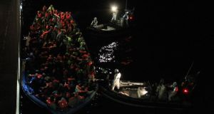 The crew of the LÉ Eithne rescuing endangered migrants in the Mediterranean. Photograph: Irish Defence Forces