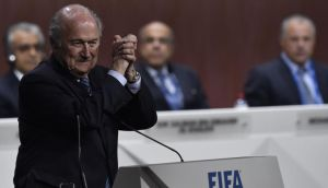 Fifa president Sepp Blatter gestures after being re-elected following a vote to decide on the Fifa presidency in Zurich. Photo: Michael Buholzer/AFP/Getty Images