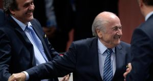 Fifa president Sepp Blatter is congratulated by Uefa president Michael Platini  after his re-election for a fifth term in Zurich. Photo: Walter Bieri/EPA