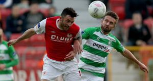 Killian Brennan of St Patrick's Athletic  battles with  Stephen McPhail of Shamrock Rovers during the  FAI  Cup second round match at  Richmond Park. Photo: Donall Farmer/Inpho