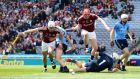 Jason Flynn and Joe Canning of Galway chase a loose ball ahead of Dublin's Cian O'Callaghan, goalkeeper Alan Nolan and Peter Kelly during the Leinster hurling quarter-final at Croke Park. Photograph: Cathal Noonan.