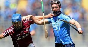 Johnny Coen of Galway tussles with Dublin's Mark Schutte during yesterday's Leinster SHC quarter-final clash at Croke Park. Photograph: Donall Farmer/Inpho