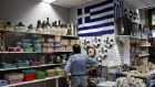 A man looks at displayed goods for sale inside a €1 shop in Athens, Greece: A forced Greek exit from the euro would create huge economic and political risks, yet Europe seems to be sleepwalking toward that outcome. Photograph: Alkis Konstantinidis/Reuters