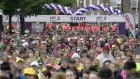 Rain doesn't dampen spirits at Women's Mini Marathon