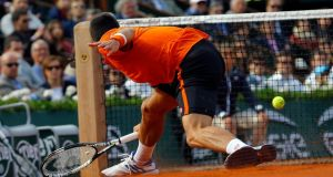 Novak Djokovic of Serbia in action against Richard Gasquet of France during their fourth round match for the French Open tennis tournament at Roland Garros in Paris. Photo: EPA
