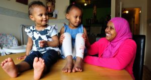 Somali speaker Iftina Abdule with her daughters Isra (3) and Ishraq (15 months) in her home in Blanchardstown, Dublin. Photograph: Aidan Crawley