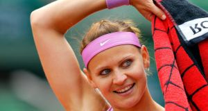 Lucie Safarova  reacts after winning against Maria Sharapova  during their fourth round match at  the French Open. Photograph:  Robert Ghement/EPA.