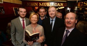 RTE newscaster Eileen Dunne with, from left, Darren Cusack, Gary Cusack, author Declan Dunne and Ger Cusack at the launch of Mulligan's: Grand Old Pub of Poolbeg Street. Photograph: Cyril Byrne