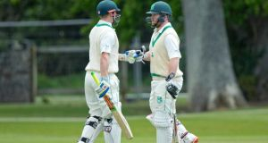 Ireland's William Porterfield and Paul Stirling congratulate each other in Malahide. Photo: Morgan Treacy/Inpho