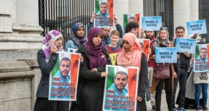 Somaia, Fatima and Omaima Halawa, sisters of Ibrahim Halawa, protest outside Government Buildings in support of their brother whose hearing has been postponed for another two months. Photograph: Brenda Fitzsimons/The Irish Times