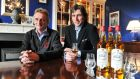 Lord Henry Mountcharles and his son Alex in the Slane Castle whiskey tasting room at Slane Castle. The whiskey company has been given a $50 million invesment. Photograph: Ciara Wilkinson