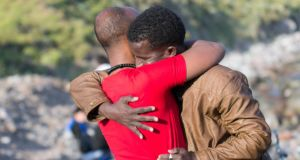Two migrants from Somalia embrace after their arrival on Lesvos on Tuesday. Photograph: Nikolas Georgiou