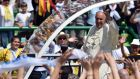 Pope Francis  gives his blessing to thousands of the faithful cheering upon his arrival in the popemobile to celebrate a mass at Sarajevo's Olympic Stadium on Saturday. Photograph: Andrej Isakovic/AFP/Getty Images.