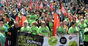 People taking part in a protest rally in Dublin on Saturday in support of a campaign for improved conditions of employment for workers at Dunnes Stores. Photograph: Eric Luke / The Irish Times
