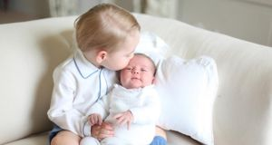 Britain's Princess Charlotte is kissed by her  brother Prince George in a photograph taken by their mother the Duchess of Cambridge in mid-May at Anmer Hall in Norfolk. Photograph:  Duchess of Cambridge via PA Wire.