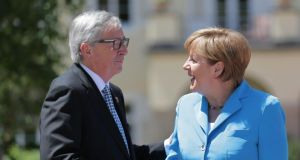 German chancellor Angela Merkel  greets president of the European Commission Jean-Claude Juncker as he arrives in  Krün in Germany for the G7 summit. Photograph: Michael Kappeler/EPA.