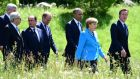 (R-L) British prime minister David Cameron, US president Barack Obama, Germany's chancellor Angela Merkel, president of the European Council Donald Tusk, French president Francois Hollande, European Commission president Jean-Claude Juncker, Canada's prime minister Stephen Harper on their way to their first working session at the Elmau Castle near Garmisch-Partenkirchen, Germany on Sunday. Photograph: John MacDougall/AFP/Getty Images.