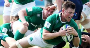 Flanker Conor Oliver scores  Ireland U20s' second try during their defeat of Scotland in the Pool C 2015 World Rugby Under 20 Championship in Italy. Photograph: Matteo Ciambelli/Inpho