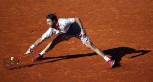 Stan Wawrinka in action against Novak Djokovic  during the men's final at the French Open  at Roland Garros in Paris. Photograph: Etienne Laurent/EPA