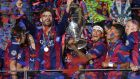 Barcelona players celebrate with the Champions League trophy after their victory over Juventus in Berlin. Photograph: Ettore Ferrari/EPA