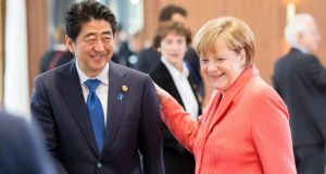 "German Chancellor Angela Merkel, once dubbed the ""climate chancellor"", hoped to revitalise her green credentials by getting the G7 nations to agree specific emissions goals. Photograph: EPA"