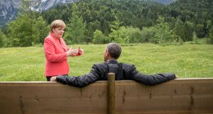 Germany's chancellor Angela Merkel chats with US president Barack Obama at a G7 summit near Garmisch-Partenkirchen in Germany. Photograph: Michael Kappeler/AFP/Getty Image