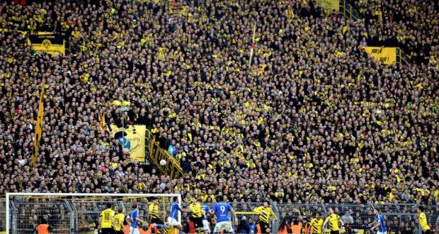 6eed63865 Borussia Dortmund's southern stand accommodates 24,454 fans for Bundesliga  matches using a rail seating system.