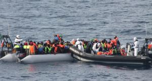 Crews from the LÉ Eithne rescuing migrants from a small craft in the Mediterranean at the weekend. Photograph: Irish Defence Forces /PA Wire
