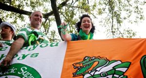 Stephen Patterson, owner of Finn McCool's Irish Pub, and singer/songwriter Tara O'Grady throw beads along the parade route during St Patrick's Day in New Orleans