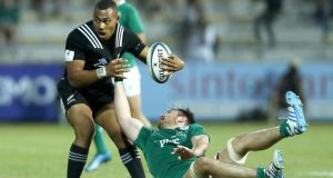 Roy Moloney tries to shackle New Zealand's Tevita Li during Ireland's 25-3 loss. Photograph: Inpho