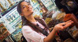 Tour guide and food lover Arva Ahmed in the spice souk.  Photograph: Airspective Media