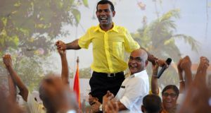 Former Maldivian president Mohamed Nasheed is greeted by supporters in Malé in February  2012, after he was ousted in a coup. He was in jailed last March to 13 years under an anti-terrorism law following a rushed trial that was condemned internationally as flawed. Photograph: Ishara S Kodikara/AFP/Getty Images
