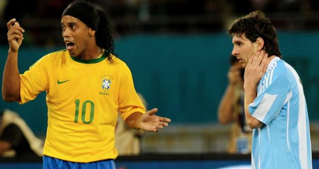 8935cc483e3 Brazil s Ronaldinho and Argentina s Lionel Messi during their friendly  football match at Khalifa Stadium in Doha
