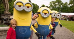 Minion magic: Rosie Comerford (6), Aaron O'Flaherty (9), Jack O'Flaherty (7) pictured with Kevin, Stuart and Bob to launch the Minions-themed family fun zone at Taste Of Dublin this weekend