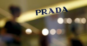 Customers walk down the stairs inside a Prada store in Hong Kong. Photograph: Reuters/Bobby Yip